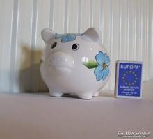 Cute ceramic piggy bank with piggy lucky four-leaf clover decoration