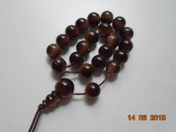 Mala with shades of brown with 21 grains and guru pearls