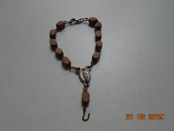 Religious pendant with small wooden pearl bracelet