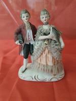 Antique porcelain love figurine with lace