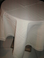 Wonderful elegant beige woven tablecloth with lacy edges