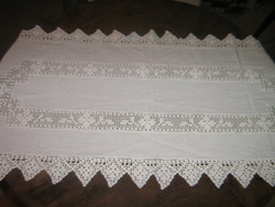 Runner with a beautiful crochet lacy insert and a snow-white tablecloth