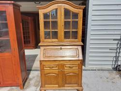 For sale an oak showcase secretary.