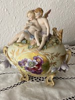 Biscuit putto hand painted eggs