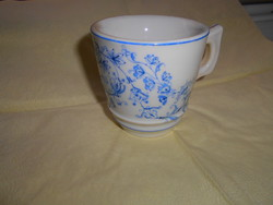 Thick, heavy porcelain cup in cafe