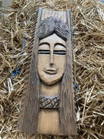 Hand carved female head