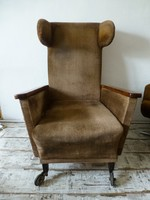 Art deco, chesterfield rolling armchair with mahogany armrests and handles