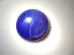 A small gemstone polished from a combination of natural richterite and sigilite. Jewelry base material. 2.8 Ct