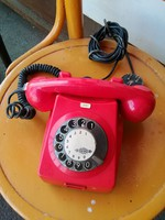 Red dial telephone with retro black dial