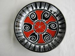 Retro craftsman in ceramic wall bowl
