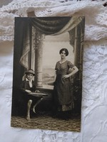Antique studio family photo sheet, barefoot little boy in hat with zither around 1920-30