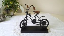 Marks & spencer design, metal bicycle mockup on wooden pedestal
