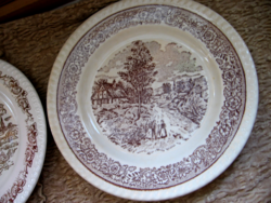 Brown and white scene of English plate in village, chatting couple