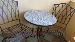 Cast iron ceramic table top garden table with 2 chairs.