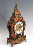 Large boulle style clock with figure on top