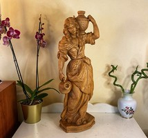 Carved woman with jugs.