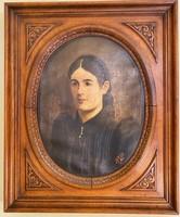 Large female portrait in ornate wooden frame