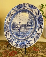 A richly decorated farmer depicting a delft faience plate