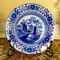 Richly decorated small delft faience plate