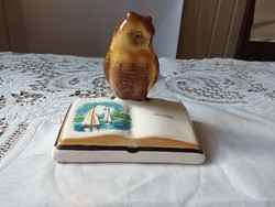 Wise owl with a book labeled Balaton